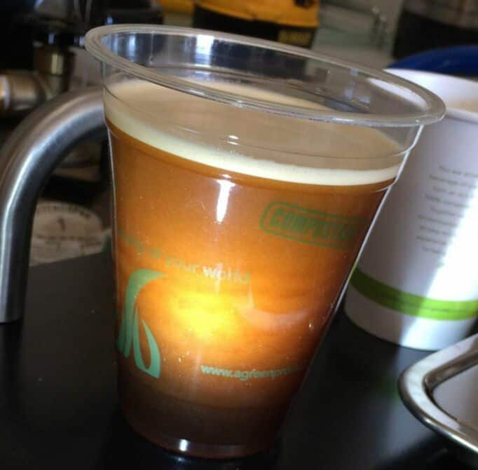 Picture of cuppers coffee cold brew nitrogen infused coffee bubbles.