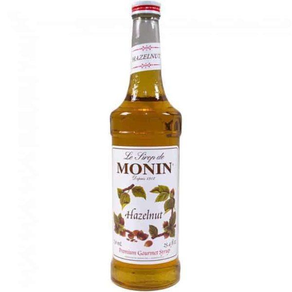 monin hazelnut syrup in glass bottle