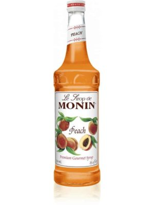 monin peach syrup in glass bottle