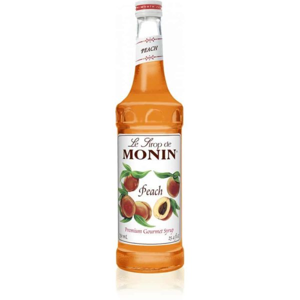 monin peach syrup in glass bottle